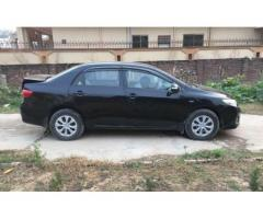 Toyota Corolla Xli Black color Excellent Condition Model 2012 Sale In Bhimber