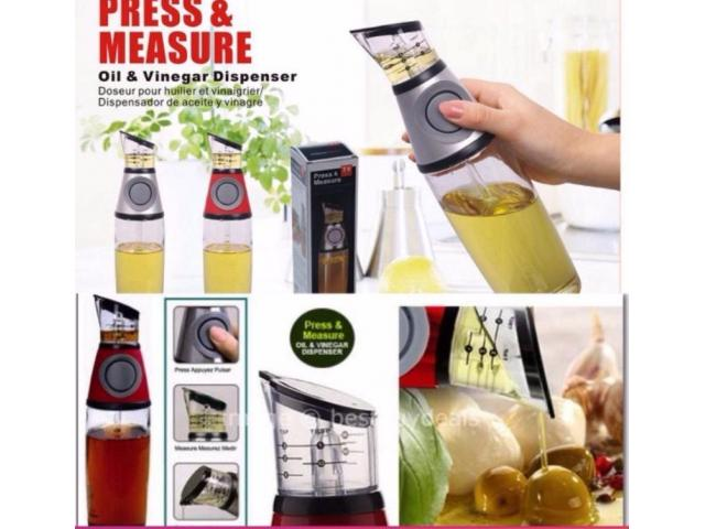 Press and Measure Oil and Vinegar Dispenser Low Price with Home Delivery