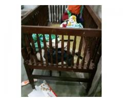 Wooden baby cot FOR SALE IN GOOD AMOUNT