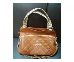 Brown Handbag/Purse NEW for sale in good amount