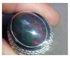 Full of fires black opal ring for sale