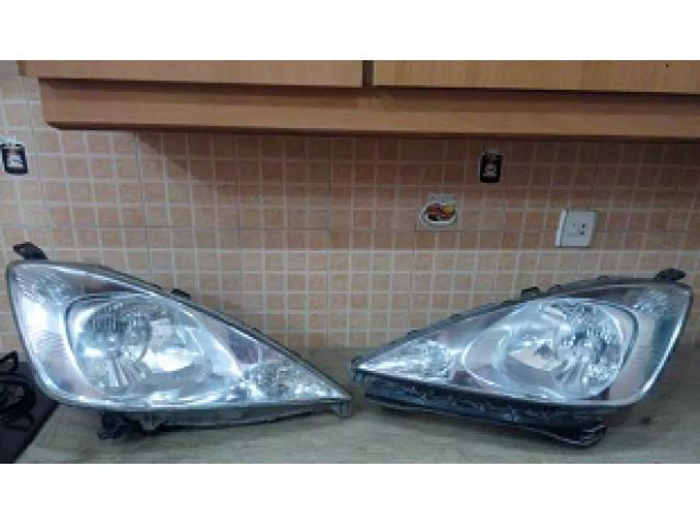 Honda fit / shuttle genuine headlights for sale in good amount