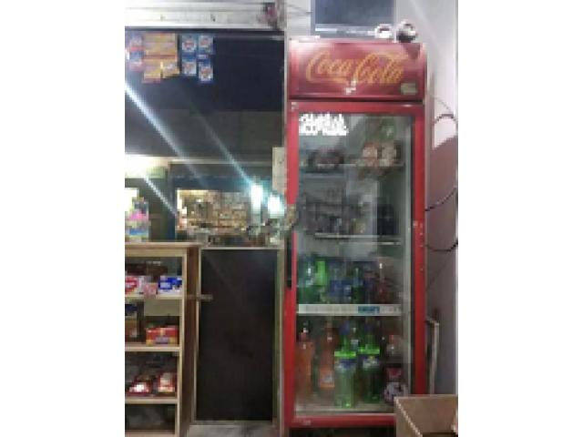 Running shop cold drink and tobacco for sale