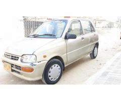 Daihatsu Coure Automatic model 2004 golden metallic color for sale