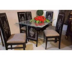 Slightly used 6 chairs dining set with carving for sale